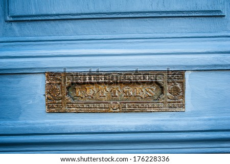 Vintage French letterbox door mailbox with beautiful LETTRES inscription on its metallic space. Beautifully blue painted - stock photo