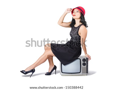 Vintage full body portrait of young asian woman sitting on 70s tv set. Classic fashion styling - stock photo