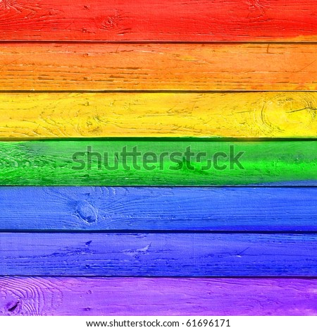 Vintage Gallery: Grunge wooden colored background - rainbow paints on old fence - stock photo