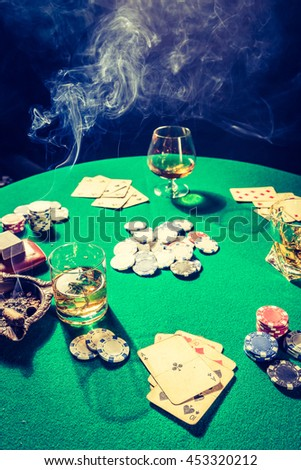 Vintage gambling table with chips and cards - stock photo