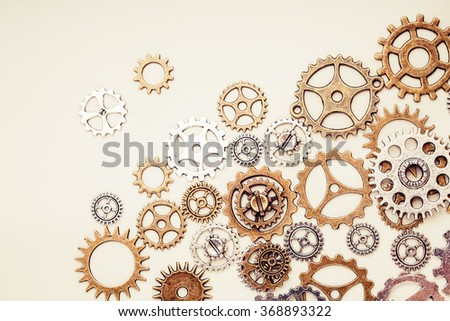 vintage gear wheels on light background - stock photo