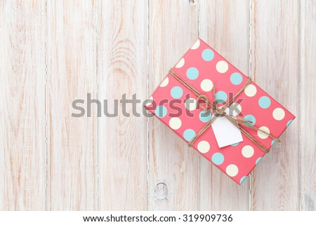 Vintage gift box over white wooden table. Top view with copy space - stock photo