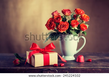 Vintage gift box with a red ribbon and flowers, Valentine's Day - stock photo