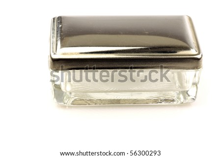vintage glass and metal soapbox isolated on a white background