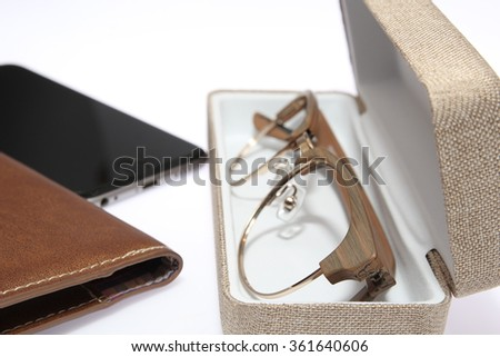 vintage glasses frame with case,notebook and smart phone