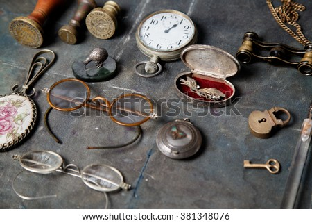 Vintage glasses, watch, stamp,lock on the old wooden desk - stock photo