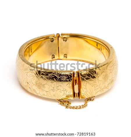 Vintage gold bangle from low perspective isolated on white. - stock photo