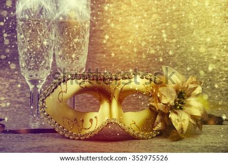 Vintage gold carnival mask on a gold background. - stock photo