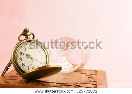 vintage gold pocket watch with old wooden box - stock photo