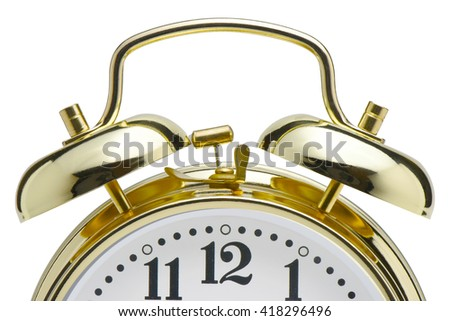 Vintage golden alarm clock on white background