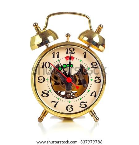 Vintage golden alarm clock on white background showing one o'clock - stock photo