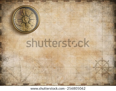 vintage golden compass with nautical map background - stock photo