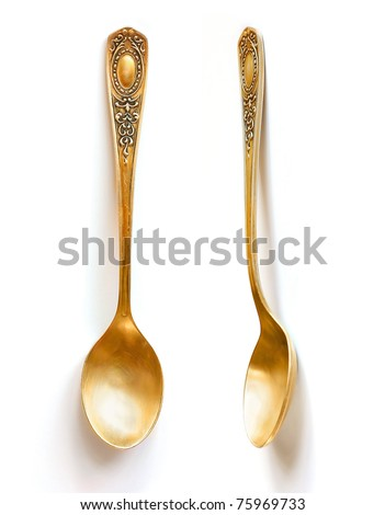 vintage golden spoon - stock photo
