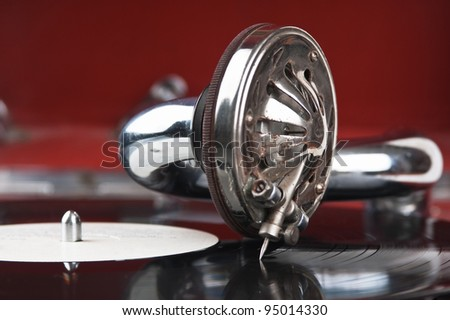 Vintage gramophone with a vinyl - stock photo