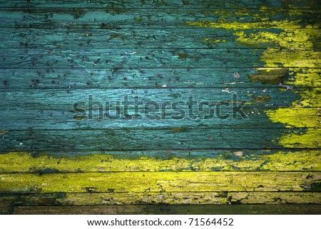 vintage green and yellow painted wooden wall - stock photo
