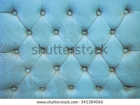 Vintage green-blue sapphire color leather upholstery buttoned sofa (background) - stock photo