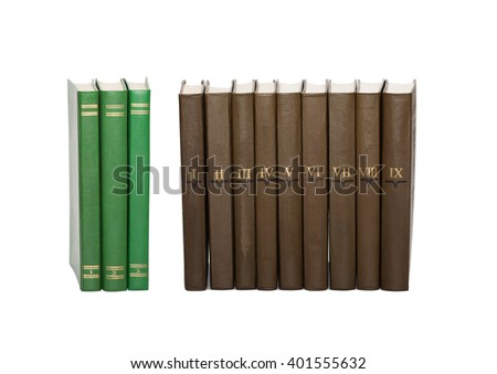 Vintage green books and brown books with serial numbers on covers. White background, soft focus - stock photo