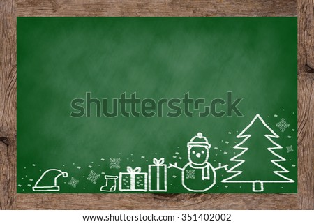 vintage green chalkboard background texture with handwritten adorable doodle of Christmas festival celebration decorate.blackboard wallpaper with wooden frame with doodle cartoon of xmas day concept. - stock photo