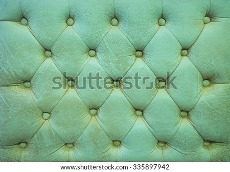 Vintage green turquoise leather upholstery buttoned sofa (background) - stock photo