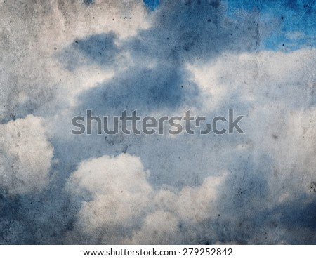 Vintage grunge background of blue sky with clouds