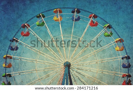 Vintage grunge background with colorful ferris wheel