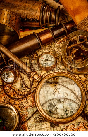 Vintage grunge still life. Vintage items on ancient map in 1565. - stock photo