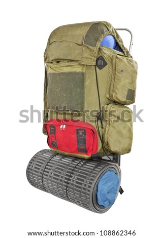 Vintage grungy backpack isolated with clipping path. - stock photo