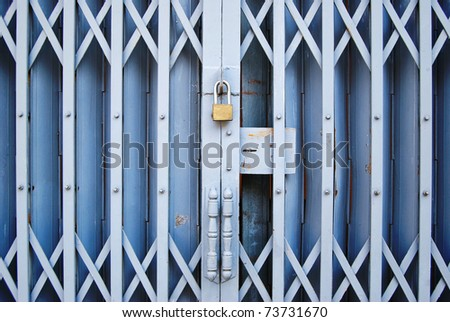 vintage grungy style locked old metal door background - stock photo