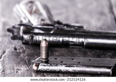 vintage handgun bullets on magazine - stock photo