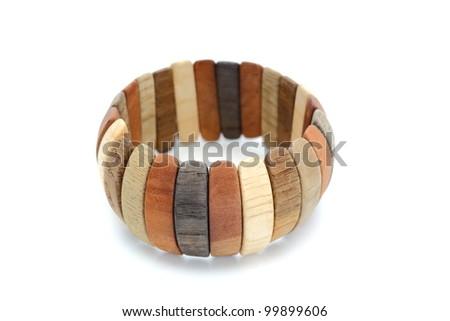 vintage handmade wooden bracelet over white background - stock photo