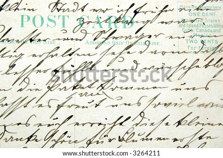 Vintage handwriting on a postcard - stock photo