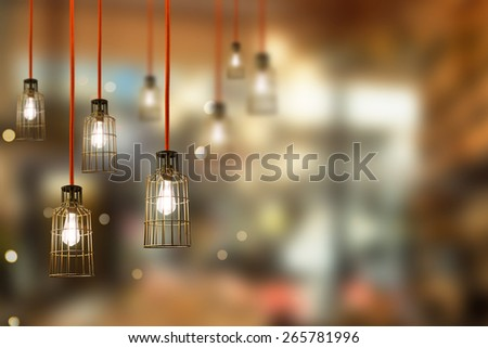 vintage hanging energy light bulbs indoor blur background - stock photo