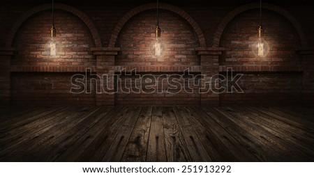 Vintage hanging energy light bulbs on brick wall background - stock photo