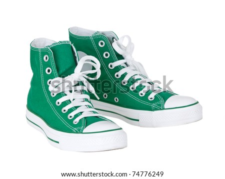 Vintage hanging green shoes on pure white background - stock photo