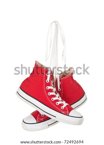 Vintage hanging red shoes tied on pure white background
