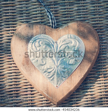 Vintage heart lies on a wicker chair in the garden view from above - stock photo