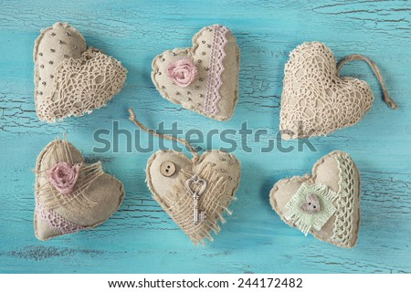 Vintage hearts on a wooden background - stock photo