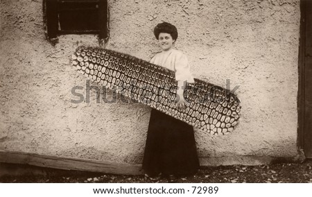 Vintage hoax photo of woman with huge ear of corn - stock photo