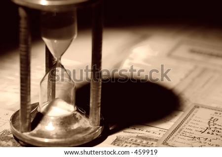 Vintage Hourglass and old Letters - stock photo