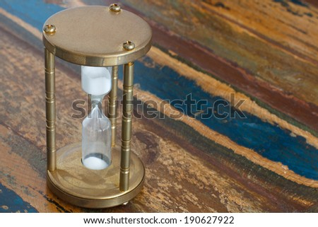 Vintage hourglass on wooden table, selective focus - stock photo