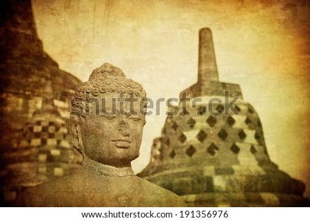 Vintage image of Buddha statue at Borobudur temple, Java, Indonesia  - stock photo