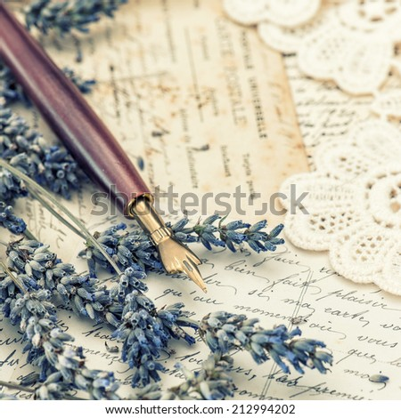 vintage ink pen, dried lavender flowers and old love letters. retro style toned picture - stock photo