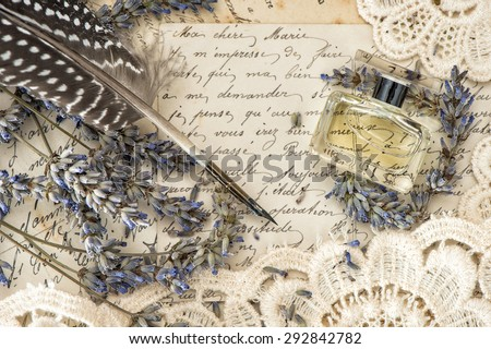 vintage ink pen, perfume, lavender flowers and old love letters. retro style toned picture - stock photo