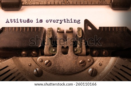 Vintage inscription made by old typewriter, attitude is everything - stock photo