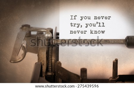 Vintage inscription made by old typewriter, If you never try, you'll never know - stock photo