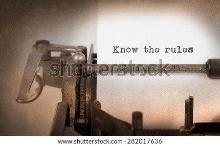 Vintage inscription made by old typewriter, Know the rules - stock photo