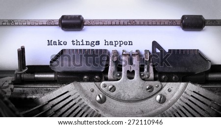 Vintage inscription made by old typewriter, make things happen - stock photo