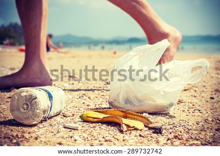 Vintage instagram style picture of garbage left by tourists on a beach, environmental pollution concept picture. - stock photo