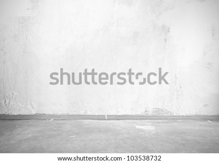 Vintage interior of stone wall and gray floor - stock photo