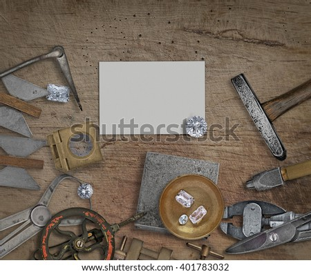 vintage jeweler tools and diamonds on a bench, space for text on business card - stock photo